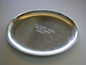Marking with the laser the bottom of a pocket watch with a pattern and text