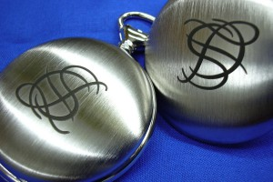 Engraving of a logo on the cover of a pocket watch