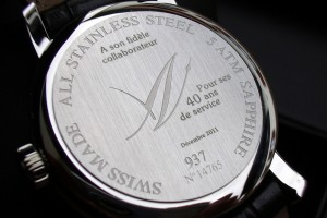 Laser marking of a personalized message / diverse technical information on the bottom of a watch