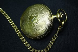 Engraving of an old golden Swiss pocket watch of initials