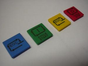 Marquage laser sur des boutons en plastique de couleurs diverses. Icones gravés pour utilisation spécifique.